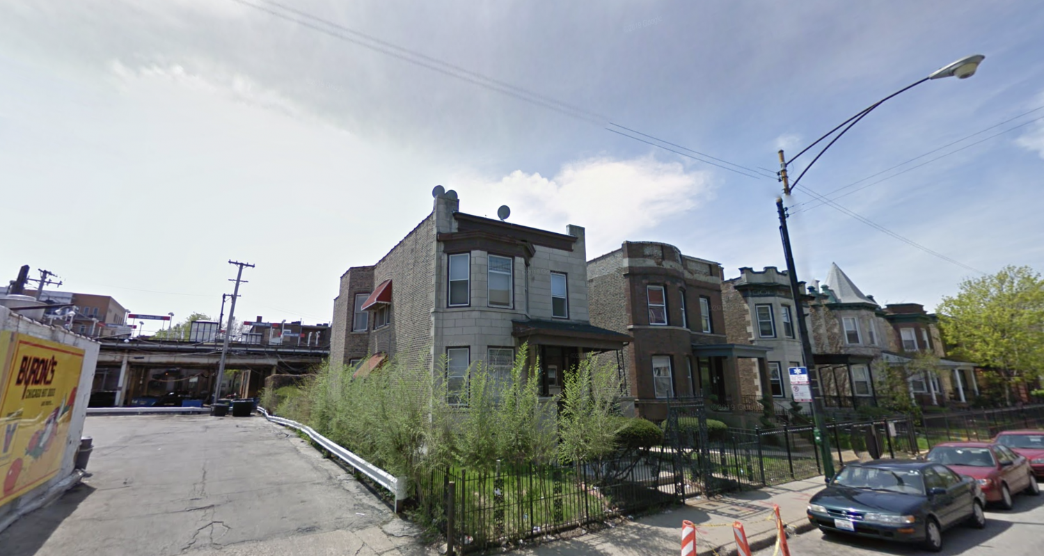 A two-story gray brownstone originally occupying 1023 W Irving Park Road